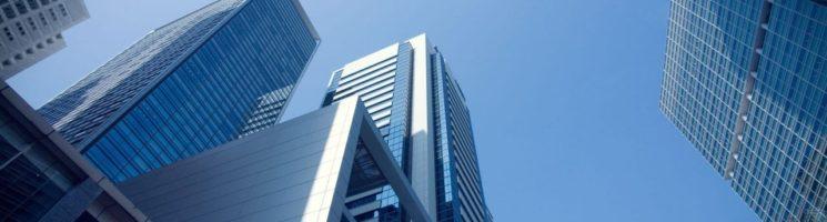 Por que obter certificado digital para condomínios - Prédios altos com o céu de fundo - Penta Certificação Digital
